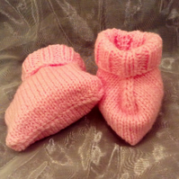 Pink knitted baby booties