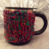 Multicoloured knitted mug warmer