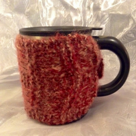 Pink knitted mug warmer