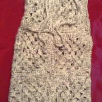 Grey crocheted hot water bottle cover