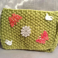 Little green decorative knitted mug warmer