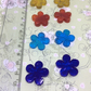 8 little glass flower embellishments