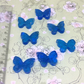 7 little glass butterfly embellishments