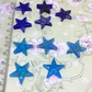 10 little glass star embellishments
