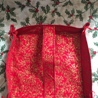 Decorative red and gold holly fabric square basket