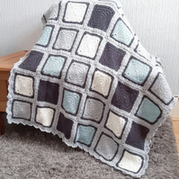 Handmade crochet blanket. A perfect keepsake. Grey and duck egg blue squares.