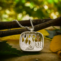 Fox and shimmering star silver and gold necklace pendant