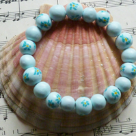 Dainty handcrafted turquoise flower bead bracelet