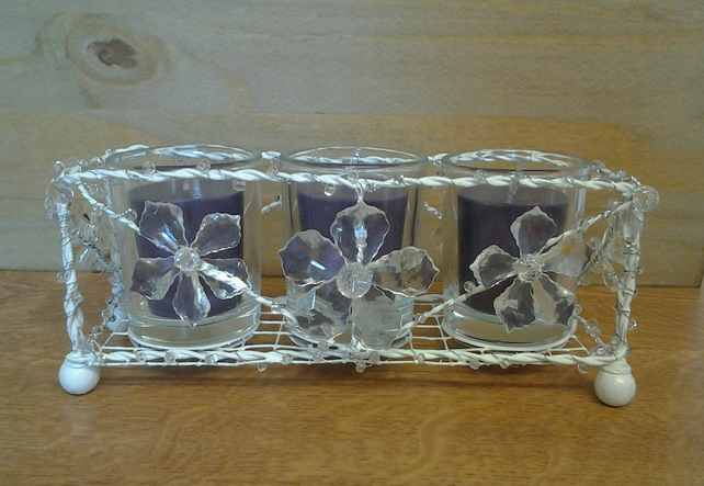 Wire candle holder with scented candles