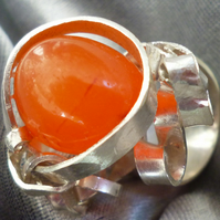 Sterling silver ring wrapped around a carnelian stone