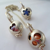 Sterling silver pendant locket with 5 different coloured marbles.