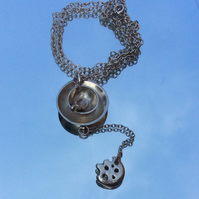 Cup of tea pendant with biscuit