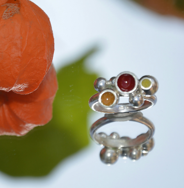 Sterling silver ring filled with vibrant red, yellow and orange enamel.