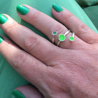 Sterling silver and florescent lime green enamel adjustable wrap ring.