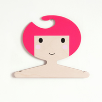 Children's bright pink girl shaped plywood clothes hanger.