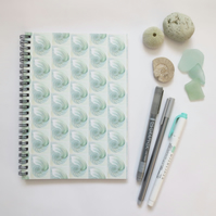 Chambered nautilus shell cover design in green spiral notebook A5 lined paper