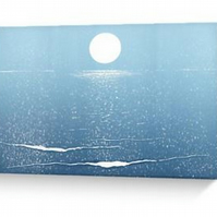 Blank greeting card moon sparkling over the ocean