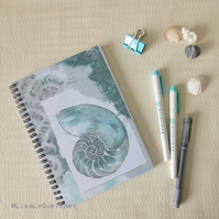 Spiral A5 (6x8) notebook repro of a chambered nautilus shell collage cover