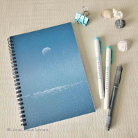 Spiral bound A5 (6x8) notebook with a moon sparkling over the ocean on the cover