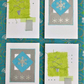 Four pack of modern xmas cards snowflakes and trees (g)