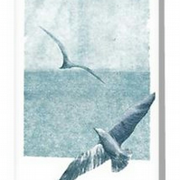 Blank art card of gulls soaring over the ocean