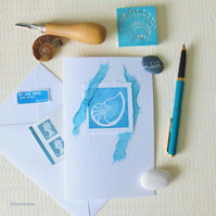 Handmade blank art card of a seashell in turquoise and aqua