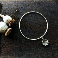 Sterling silver bangle with poppy seed head, poppy jewellery