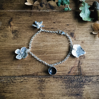 Sterling silver charm bracelet with four seasons charms - daffodil, ivy, acorm