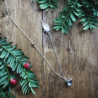 Long sterling silver necklace with leaf and acorn cap