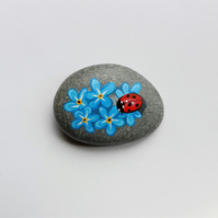 Ladybird on Forget-me-knots stone