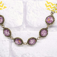 Purple Flower Glass and Antiqued Bronze Bracelet