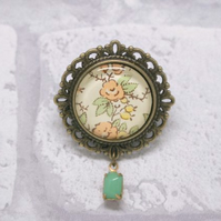 Peach and Yellow Glass Brooch with Green Milk Glass Drop