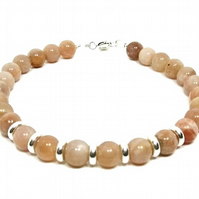 Peach Pink Sunstone Bracelet With Sterling Silver Beads