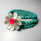 Silver, pink centred flower on turquoise bracelet