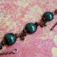 Gorgeous Green Lampwork bead and semi-precious red agate bracelet