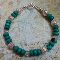 Turquoise and Silver Filigree Bead Bracelet.