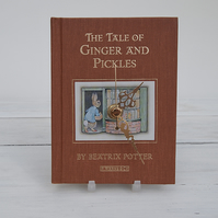 The Tale of Ginger & Pickles by Beatrix Potter book clock.