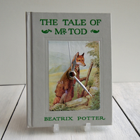 The Tale of Mr. Tod by Beatrix Potter book clock.