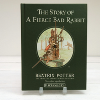 The Story Of A Fierce Bad Rabbit by Beatrix Potter book clock.