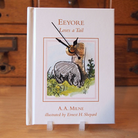 Winnie The Pooh book clock, featuring Eeyore Loses A Tail by A. A. Milne.