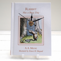 Winnie The Pooh book clock, featuring Rabbit Has a Busy Day by A. A. Milne.