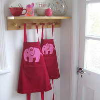 Childs apron, age 1-2 yrs, deep pink cotton, hand appliquéd pink elephant.