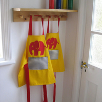 Age 1-2 yrs. Red 'Efalant' hand appliquéd child's yellow apron