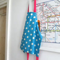 Childs apron, age 1-2 years, spotty blue cotton with bright pink ties.
