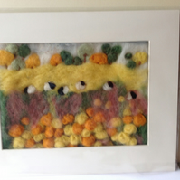 Felt picture sheep grazing in the meadow.