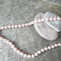Swarovski pearl necklace with heart toggle clasp.