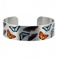 Narrow metal cuff bracelet in brushed silver with butterflies. B274