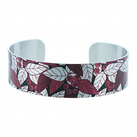 Brushed silver narrow metal cuff bracelet with burgundy red leaves. B355