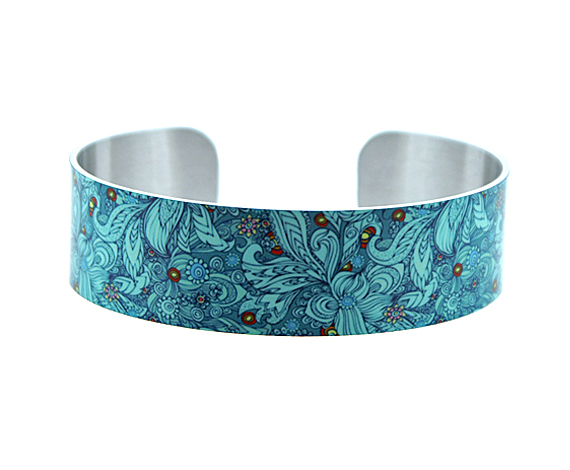 Artistic jewellery bracelet, narrow metal cuff with teal floral design. B137