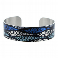 Artistic jewellery cuff bracelet, brushed silver, blue with black daisies. B280